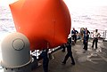 US Navy 060617-N-7711S-208 Weapons Department Sailors push an inflatable balloon used for target practice into the water from the fantail aboard the Nimitz-class aircraft carrier USS Ronald Reagan (CVN 76).jpg