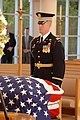 US Navy 061229-A-0607L-004 Captain Christopher Brooke from 3rd U.S. Infantry Regiment, also known as The Old Guard, stands at attention near the casket of former President Ford.jpg