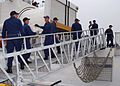 US Navy 070409-N-8544C-008 Coast Guardsmen assigned to the Coast Guard Cutter Northland (WMEC 904), offload 2,400 pounds of cocaine and four bales of marijuana seized off the coast of Columbia March 10, 2007.jpg