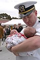 US Navy 070420-N-9604C-004 Lt. Cmdr. Brad Donnely embraces his newborn son and daughter upon returning from a three-month surge deployment on board USS Ronald Reagan (CVN 76).jpg
