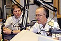 US Navy 070521-N-2908O-006 Rear Adm. Fred Byus, the U.S. Navy's Oceanographer and Navigator and Cmdr. David Hebert talk on the radio about upcoming events during Little Rock Navy Week.jpg