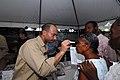 US Navy 070902-N-8704K-118 Cmdr. Octavio Borges, attached to Military Sealift Command hospital ship USNS Comfort (T-AH 20), provides optometry services for Mergueritte Petiote at Hopital De L'universite D'etat D'Haiti.jpg