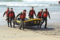 US Navy 080116-N-2738S-024 Basic Underwater Demolition-SEAL students bring their boat out from the water after a surf passage exercise.jpg