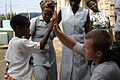 US Navy 080121-N-1429M-148 A local Sao Tomean boy gives a.jpg