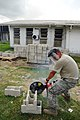 US Navy 081113-N-4515N-013 Air Force Staff Sgt. Richard Monsalve cuts cinder blocks to build a wall for a canteen at West Demarara Regional Hospital.jpg