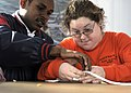 US Navy 081212-N-1831S-118 Boatswain's Mate 2nd Class Jamie Marriott helps a student from the LifeSkills Learning Center tie a square knot.jpg