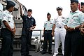 US Navy 090519-N-4811K-002 Mineman 3rd Class Jeremy Holloway explains the minesweeping gear aboard the mine countermeasures ship USS Patriot (MCM 7) to members of the Armed Forces of the Philippines.jpg