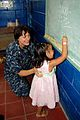 US Navy 090628-F-7885G-097 Lt. Cmdr. Kelly Hamon, embarked aboard the Military Sealift Command hospital ship USNS Comfort (T-AH 20), examines a young girl while she draws on the chalkboard during a Continuing Promise 2009 medic.jpg