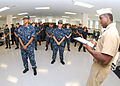 US Navy 090817-N-7682E-003 Senior Chief Electronic Technician Mark Prince reads a letter to the recruits of Division 338, Ship ^ 9, USS John F. Kennedy at Recruit Training Command Great Lakes.jpg
