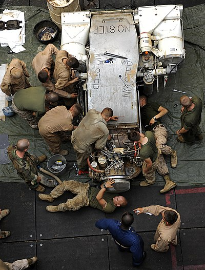 US Navy 091015-N-5345W-152 Marines assigned to Combat Logistics Battalion (CLB) 22 of the 22nd Marine Expeditionary Unit (22nd MEU) replace the engine of an M1A1 Abrams main battle tank.jpg