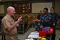 US Navy 100106-N-0603N-216 Rear Adm. Joseph F. Kilkenny talks with students about the Basic Engineering Core Course at the Center for Naval Engineering Learning Site.jpg