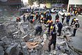 US Navy 100117-N-6070S-001 Members of the Los Angeles County Fire Department Search and Rescue Team clear debris at a collapsed building in downtown Port-au-Prince.jpg