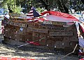 US Navy 100128-N-8828S-618 Earthquake survivors erect a cardboard monument at the Petionville Country Club in Port-au-Prince, Haiti.jpg