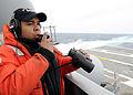 US Navy 100227-N-3885H-095 Seaman Kyle Tugman stands port lookout aboard USS George H.W. Bush (CVN 77).jpg