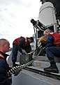 US Navy 100425-N-4516G-110 Combat systems department Sailors load ammunition into a close-in weapons system aboard the nuclear-powered aircraft carrier USS Enterprise (CVN 65).jpg