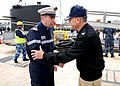 US Navy 100511-N-7705S-090 Capt. Chris Thomas greets Cmdr. Christian Houette following his arrival at Naval Station Norfolk.jpg