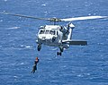 US Navy 100719-N-6720T-104 Explosive Ordnance Disposal Technician 2nd Class Jonathan Tatman is hoisted by an HH-60H Sea Hawk helicopter during cast and recovery training.jpg