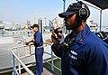 US Navy 101121-N-7948R-063 Yeoman 1st Class Jason McClinton talks on a sound powered phone aboard the amphibious dock landing ship USS Pearl Harbor.jpg