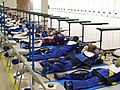 US Navy 110212-N-FO977-329 Navy Junior Reserve Officers Training Corps cadets line up in the prone firing position during the 2011 NJROTC Air Rifle.jpg