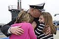 US Navy 110408-N-8467N-006 Senior Chief Sonar Technician (Submarine) Matthew Lindsey hugs his wife and daughter after returning from deployment.jpg