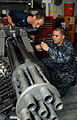 US Navy 110603-N-QL471-056 Aviation Ordnanceman 2nd Class Mark Gill, left, and Aviation Ordnanceman Airman Jon Blankenship perform maintenance on a.jpg