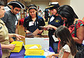 US Navy 110626-N-WE887-073 Interns from the National Museum of the United States Navy work together creating small history books for children durin.jpg