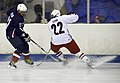 US Navy 110828-N-RI884-134 Dave Taylor, left, captain of the Navy, Marine Corps, and Coast Guard hockey team, challenges Russ Quinn of the Army and.jpg