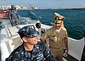 US Navy 111120-N-UE250-068 Rear Adm. Mark Buzby, commander of Military Sealift Command, speaks with Boatswain's Mate 2nd Class Daniel Walker, assig.jpg