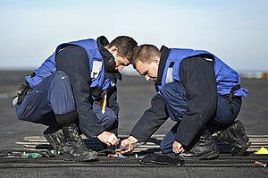 US Navy 120131-N-XE109-104 Sailors replace the chemical lights on a phone and distance line.jpg