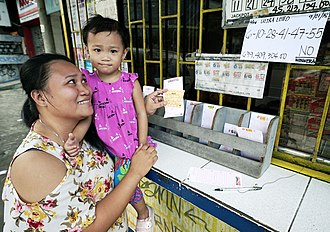 Gambling in the Philippines - A woman place her bet on the Ultra Lotto 6/58.