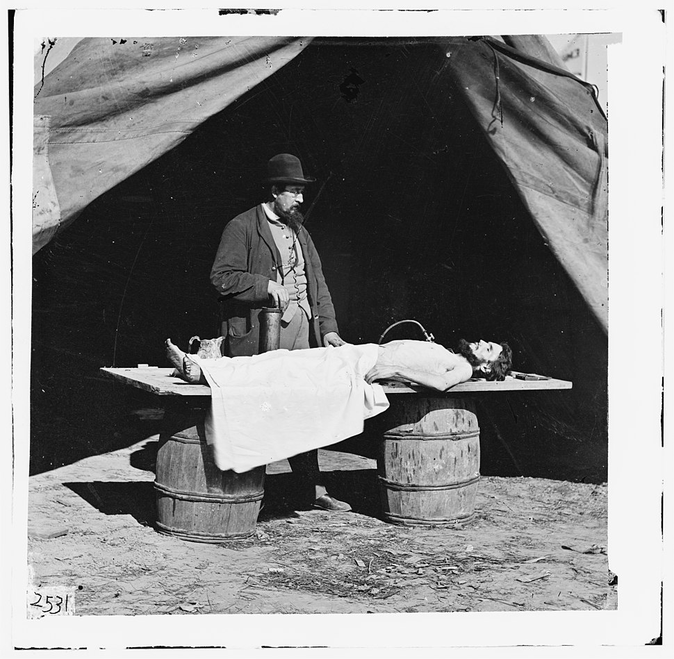 Unknown location. Embalming surgeon at work on soldier's body LOC cwpb.01887