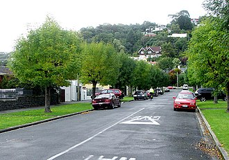 St Clair, New Zealand - Valpy Street is named for the suburb's founding father, W.H. Valpy. His homestead was located close to the brown and white house on the slopes of Forbury Hill in the background of this picture.
