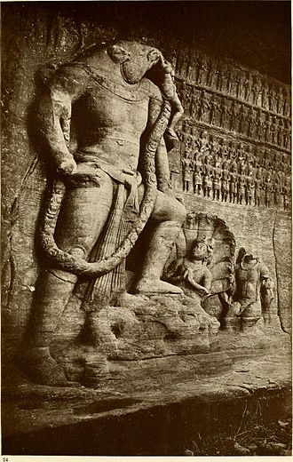 Udayagiri Caves - Udayagiri, Cave 5, Viṣṇu as Varāha, showing god controlling the waters, personified as a serpent (nāga), and carrying the earth goddess on his tusk.