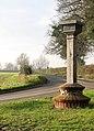 View west along Kirby Road past Bramerton village sign - geograph.org.uk - 1620265.jpg