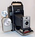 Vintage Polaroid Model 900 Instant Electric Eye Camera, Used Polaroid Picture Roll Land Film, Made In USA, Circa 1960 - 1963 (35232779444).jpg