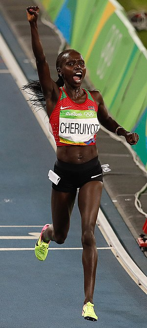 Athletics at the 2016 Summer Olympics – Women's 5000 metres - Vivian Cheruiyot celebrates as she finishes