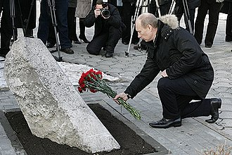 Novocherkassk massacre - President of Russia Vladimir Putin lays flowers, on 1 February 2008, at the memorial to the victims of the massacre.