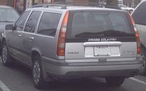 Rear view of silver V70 XC with black 'Cross Country' decal on the tailgate