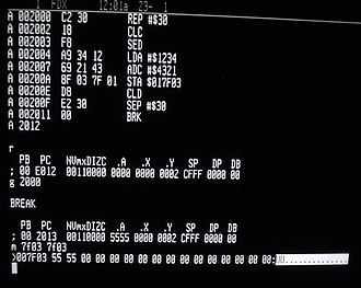 Machine code - Machine language monitor in a W65C816S single-board computer, displaying code disassembly, as well as processor register and memory dumps.