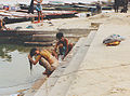 Washing female and man in Varanasi.jpg