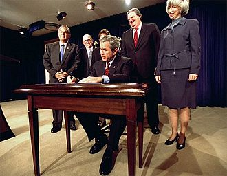 Gale Norton - Gale Norton stands by President George W. Bush and other dignitaries at the signing ceremony of a bill.