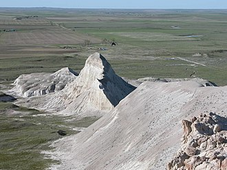 White Butte - A view of the shark fin rock from the top of the butte.
