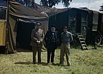 Winston Churchill flanked by the Chief of the Imperial General Staff, Field Marshal Sir Alan Brooke and General Sir Bernard Montgomery, commanding 21st Army Group, at Monty's mobile headquarters in Normandy, 12 June 194 TR1838.jpg
