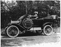Woman seated behind steering wheel of automobile LCCN2001706316.jpg