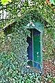 Wooden shelter overgrown with ivy.jpg