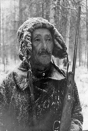 Yakuts - Sakha hunter with gun, early 20th c.