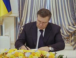 Agreement on settlement of political crisis in Ukraine - President of Ukraine Viktor Yanukovych signing the Agreement, 21 February 2014.
