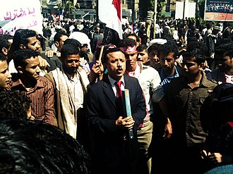 Yemeni Revolution - A television reporter in the middle of protesters in Sana'a