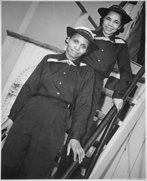 SPARS - Aileen Cooke and Olivia Hooker, two African-American SPARS, pose on the dry land ship USS Neversail during boot camp