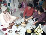(A) family puja in progress.jpg